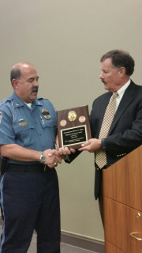 Commissioner Keller receives plaque from KSCPOST